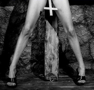 crucifix with sexy legs in high heels crucified on cross